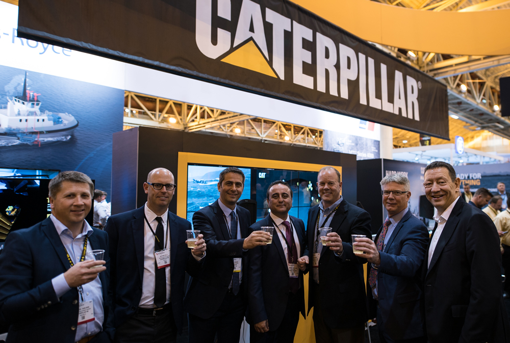 Caterpillar, Sanmar and R.A.L representatives at the signing ceremony at New Orleans Workboat Show